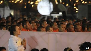 Buddhist Thais and monks take part in a mass prayer as part of New Year Eve celebrations in Bangkok, Thailand, 31 December 2011