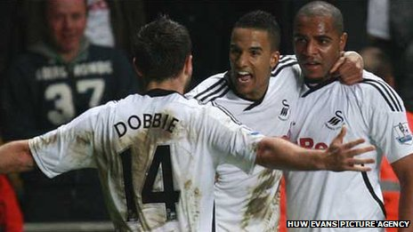 Scott Sinclair celebrates with Kemy Agustien and Stephen Dobbie