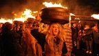 Tar Barrels are lit in readiness for the traditional Allendale New Year Tar Barrel Parade