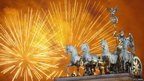 Fireworks explode over the Quadriga statue atop the Brandenburg Gate on New Year's Eve in Berlin, Germany