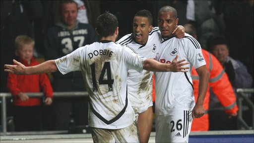 Swansea City's Scott Sinclair (centre) celebrates his goal against Tottenham Hotspur