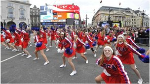 Marching bands and cheerleader troupes at Piccadilly Circus