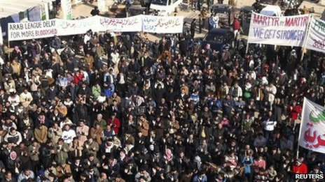 Demonstrators march against President Bashar al-Assad in Idlib, 30 December 2011.