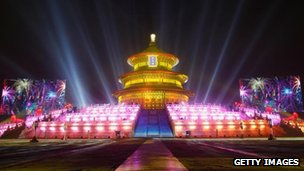 The Temple of Heaven in Beijing is illuminated as the Chinese capital celebrates New Year's Eve, 31 December 2011