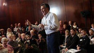 Republican presidential hopeful Mitt Romney speaks during a campaign stop on January 1, 2012 in Council Bluffs, Iowa.