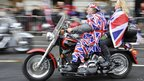 A biker riding down Piccadilly