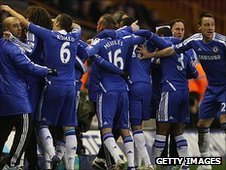Chelsea players celebrate their opening goal by Ramires