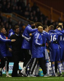Chelsea players celebrate the opening goal at Wolves with their bench