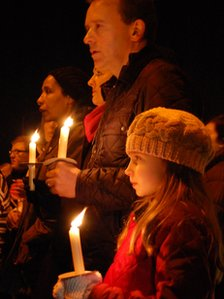 Mark Butler with daughter Charlotte at vigil for Anuj Bidve