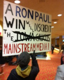 A supporters' sign outside a Ron Paul campaign event 3 January 2012