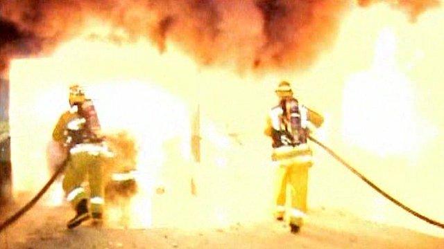 Firefighters tackling a blaze
