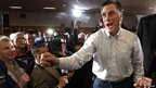 Former Massachusetts Governor Mitt Romney greets supporters at an event in Davenport, Iowa, 2 January 2012