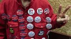 A man covers his shirt in buttons for Texas Representative Ron Paul in Des Moines, Iowa, 2 January 2012