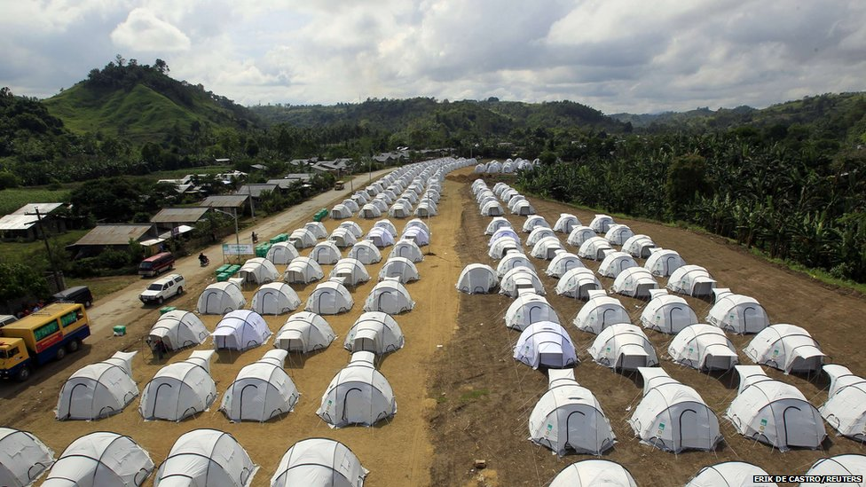 A general view shows rows of tents set up for tropical storm Washi survivors