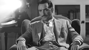 Jean Dujardin portrays George Valentin in The Artist