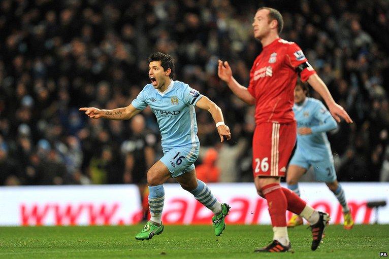 Sergio Aguero (left) celebrates after scoring against Liverpool