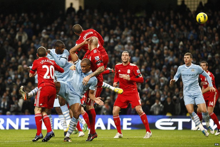 Yaya Toure (second left) scores for Manchester City