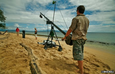 Film crew filming on a beach on the island cay known as Low Isle (c) J Brickell