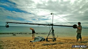 Film crew standing on beach with Jimmy Jib (c) J Brickell
