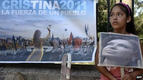 A girl holds a portrait of Argentine President Cristina Fernandez de Kirchner outside the Austral Hospital in Pilar, Buenos Aires, on 3 January 2012,