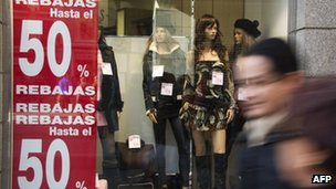 Shop window in Spain showing sale signs
