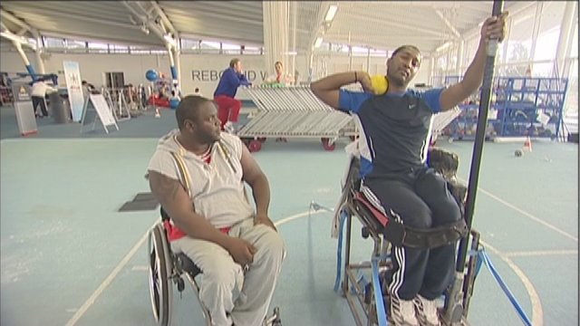 Paralympic shot-put hopeful Shaun Sewell gives tips to Dekan Apajee