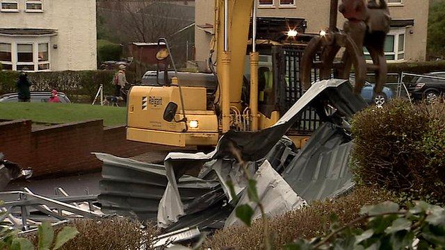 Digger removing debris