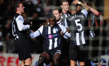 Newcastle striker Demba Ba (centre) celebrates with his team-mates