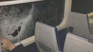 Smashed window on a train