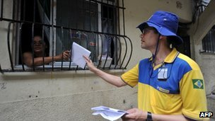 A postman delivers a letter at Rocinha shantytown in Rio de Janeiro, Brazil.