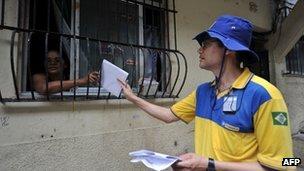 A postman delivers a letter at Rocinha shantytown in Rio de Janeiro, Brazil.