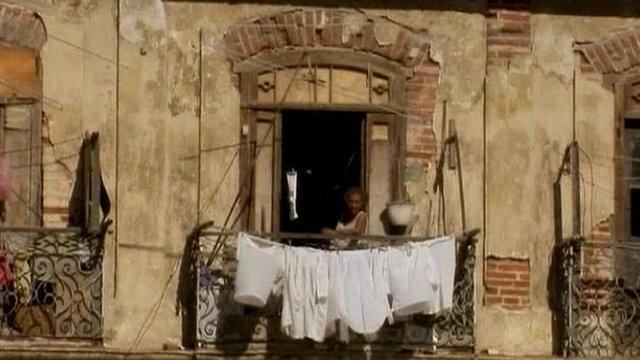 Lady on a balcony in Havana