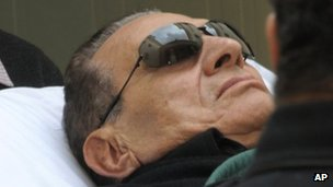 Former Egyptian president Hosni Mubarak being stretchered into court on 5 January