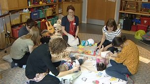 Parents and children in hospice playroom