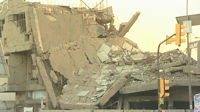 Collapsed building following explosions