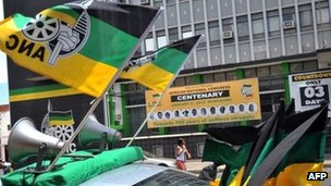 "A car decked out with ANC flags drives by in Bloemfontein on January 5, 2012 to celebrate the 100th anniversary of South Africa""s ruling African National Congress (ANC) party"