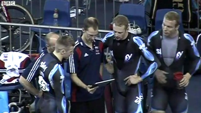 British cyclists study data on a tablet