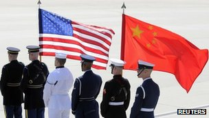 A colour guard of US. and Chinese flags awaits the plane of China&#039;s President Hu Jintao at Andrews Air Force Base, Maryland (file photo)