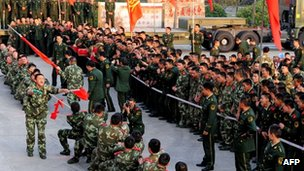 Soldiers of China&#039;s People&#039;s Liberation Army undergoing a tug-of-war at a military base in Hefei in December 2011