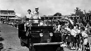 Queen Elizabeth and the Duke of Edinburgh greeted by school children in Jamaica in 1953