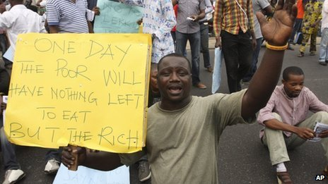 An unidentified man protests on a major road in commercial capital during a fuel subsidy protest in Lagos, Nigeria, Tuesday 3 January 2012