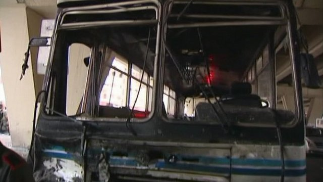 Burnt out bus following Syria blast