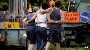 Three people bereaved by Saturday's hot air balloon crash in Carterton, north of Wellington, New Zealand, visit the crash site