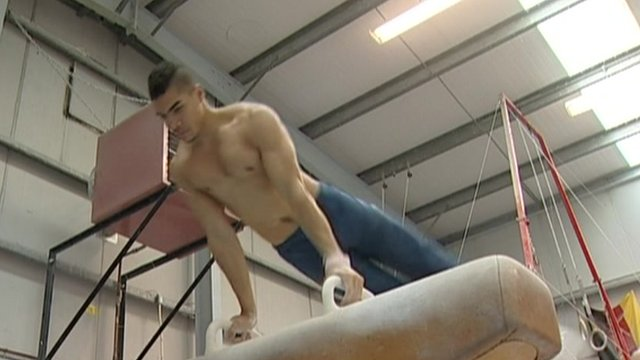Olympic medallist Louis Smith on the pommel horse