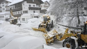 Snow ploughs try to clear the streets in Fiss, eastern Austria, on 6 January 2012.