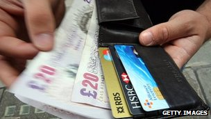 Money and credit cards in wallet