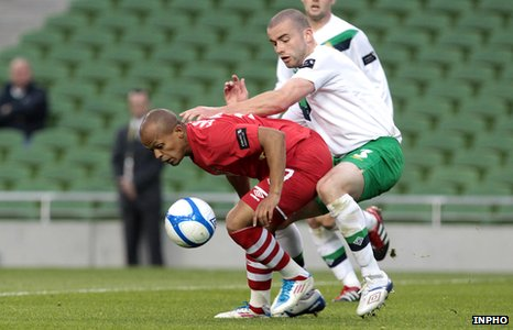 Wales striker Robert Earnshaw battles with Northern Ireland&#039;s Colin Coates last May