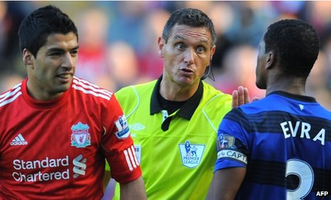 Liverpool's Luis Suarez and Manchester United's Patrice Evra on 15 October