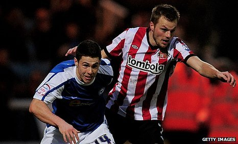 Sebastian Larsson (right) challenges with Tommy Rowe