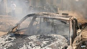 Aftermath of bomb attack near Abuja on 25 Dec